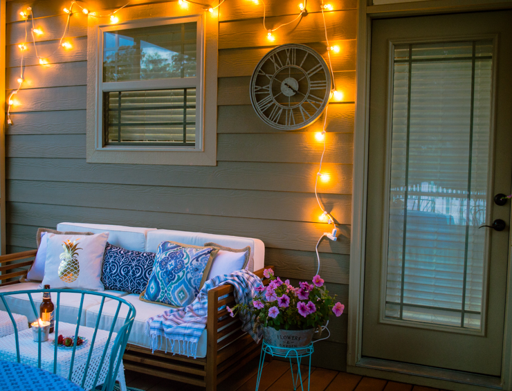 This screened in porch is amazing and has so many inexpensive decor finds and inspiration for creating an inviting outdoor room! See the full reveal at the TheHomeICreate.com
