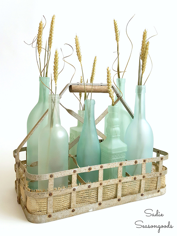 9_vintage_milk_bottle_carrier_basket_repurposed_as_coastal_beach_decor_centerpiece_with_DIY_sea_glass_bottles_Sadie_Seasongoods