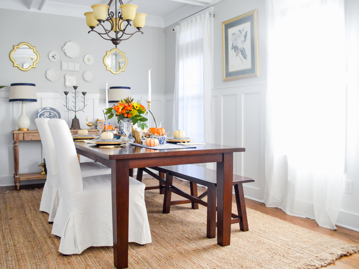 Jute rug in dining room with white slipcovered chairs