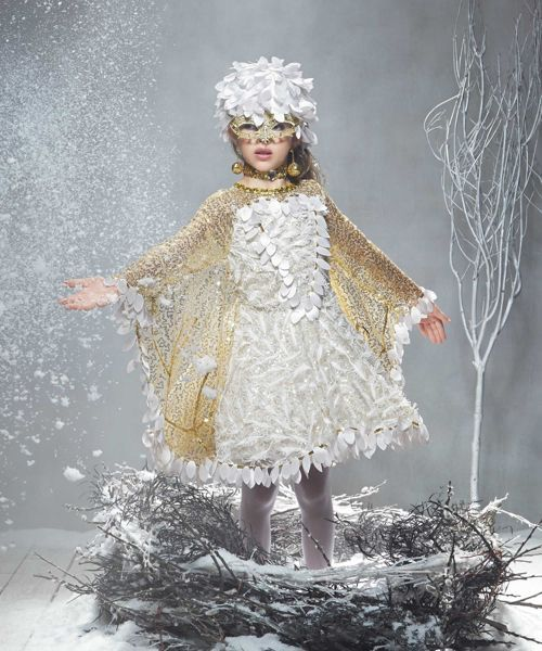 885a4e7192 ... or snowy owl/bird costume like the beautiful photo below! Just use white  and/or gold feathers {linked below} for the mask instead of the pink ones!
