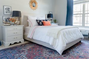 updated blue and white master bedroom, with neutral decor accents.