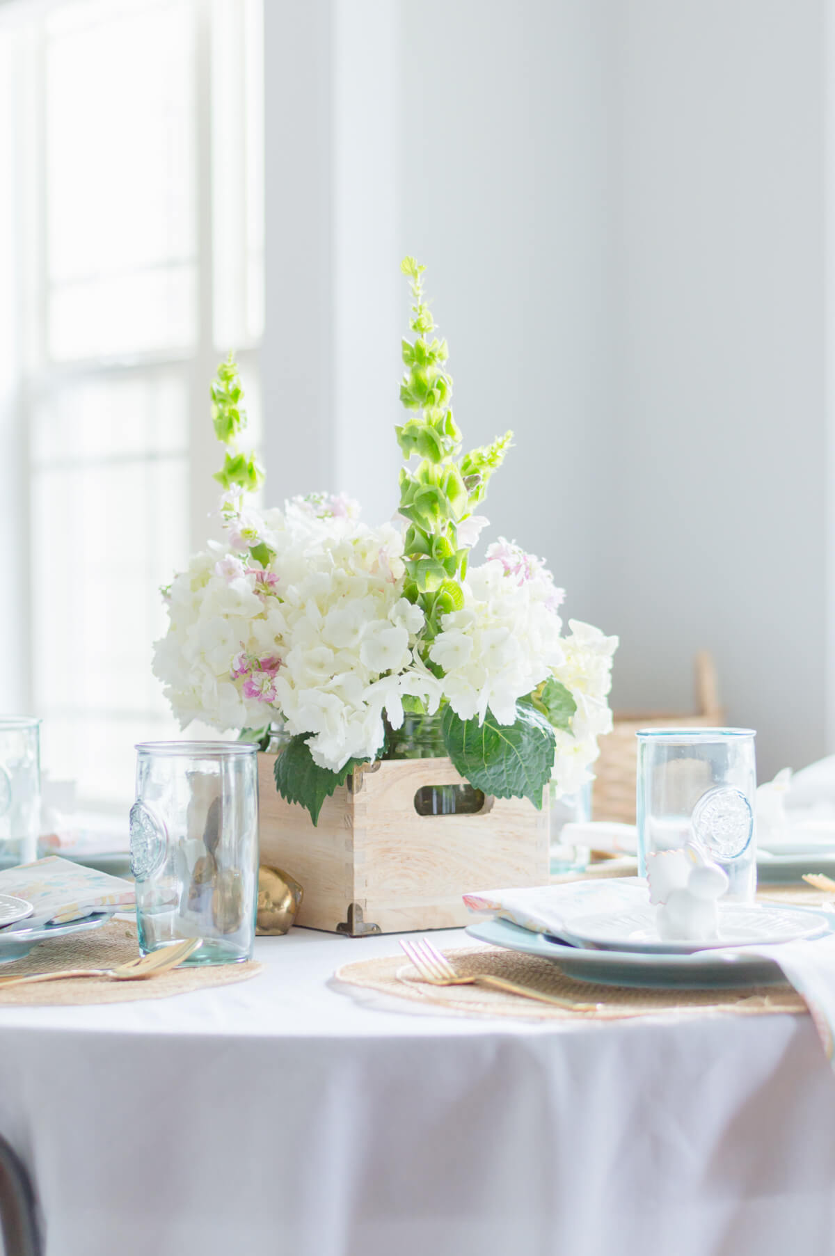 Beautiful and simple spring tablescape with gold flatware. Easter place settings with ceramic bunny place card holder