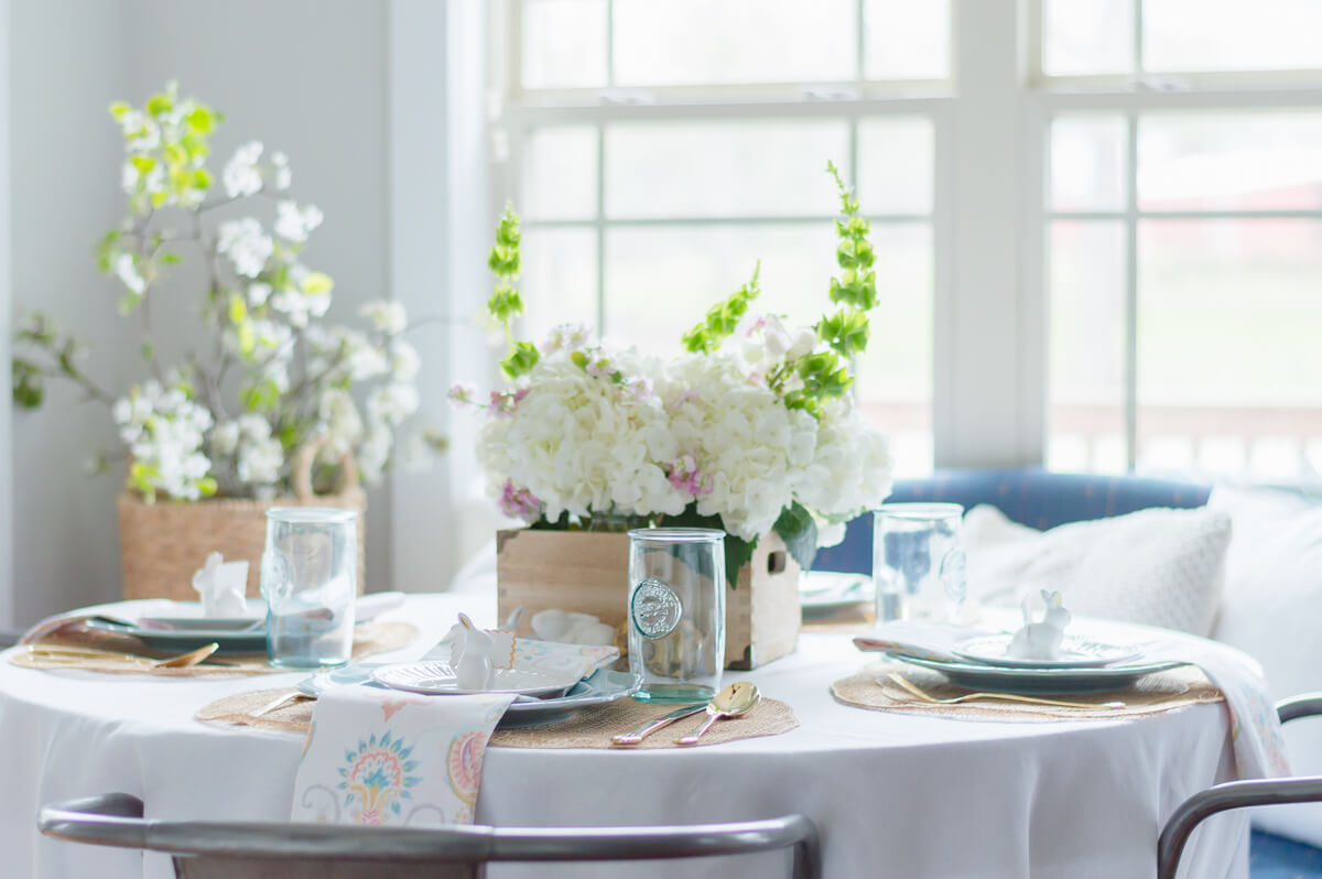 Beautiful and simple spring tablescape with gold flatware. Easter place settings with ceramic bunny place card holder   thehomeicreate.com