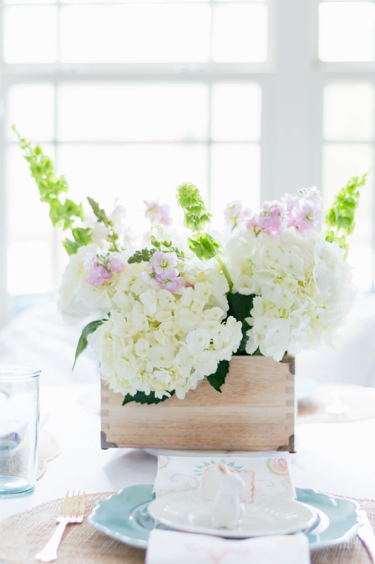 Easy DIY spring flower arrangement made with grocery store flowers hydrangea! Great for Easter tablescapes and spring decor!