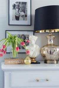 Light bright spring bedroom ideas with nightstand styling | campaign dresser | gold bamboo mirror.