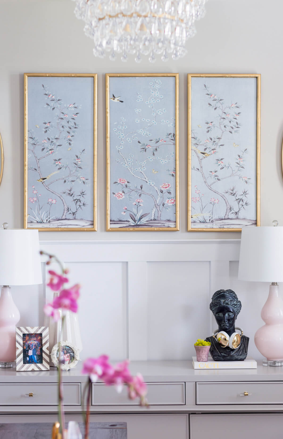 Chic and girly home office with chinoiserie panels, DIY Gold chandelier, pink lamps, vintage bust.