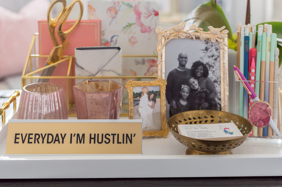 Chic and girly home office with farmhouse trestle table, DIY Gold chandelier, desk styling.