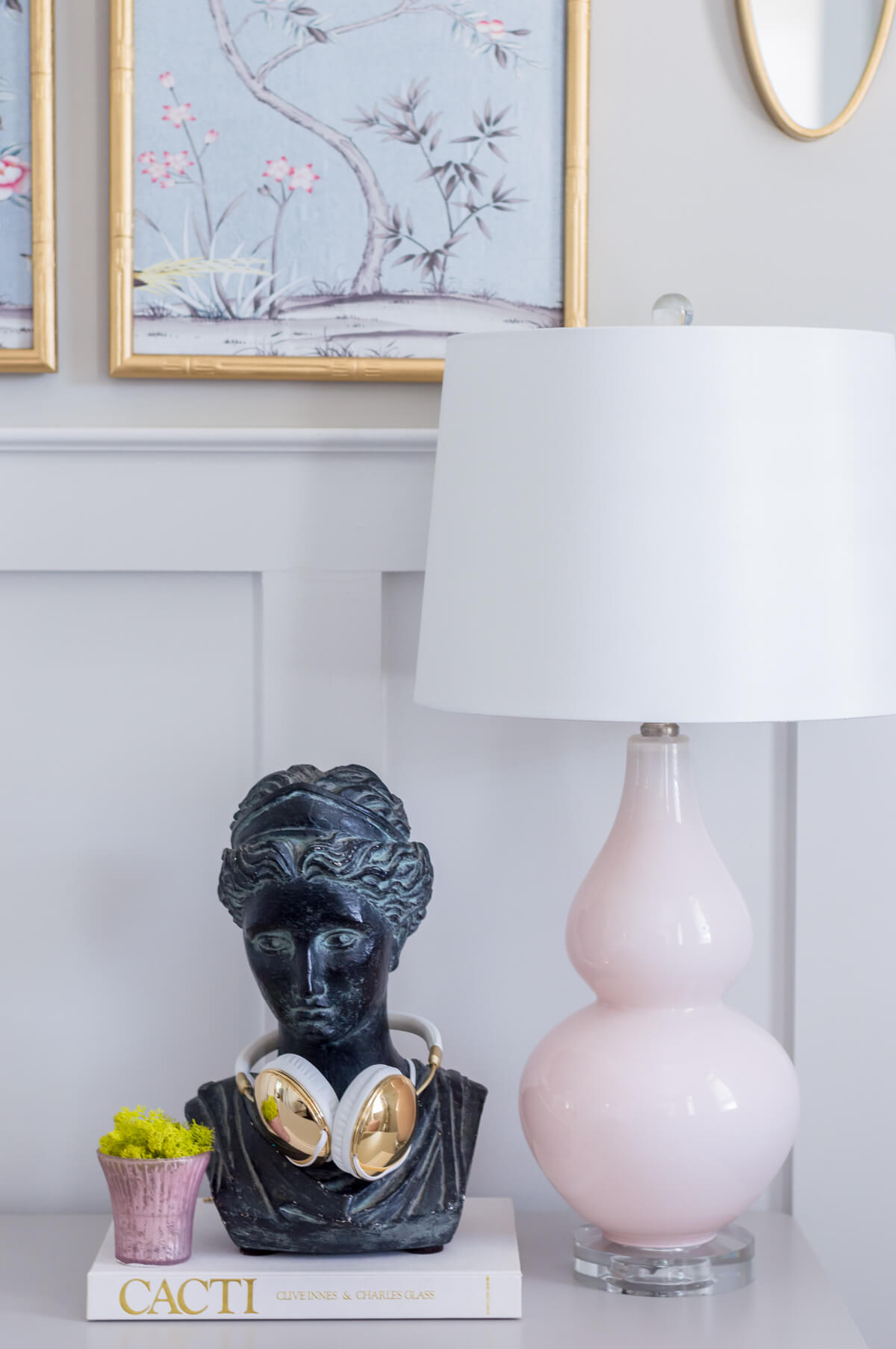 Chic and girly home office with vintage bust, pink lamp.