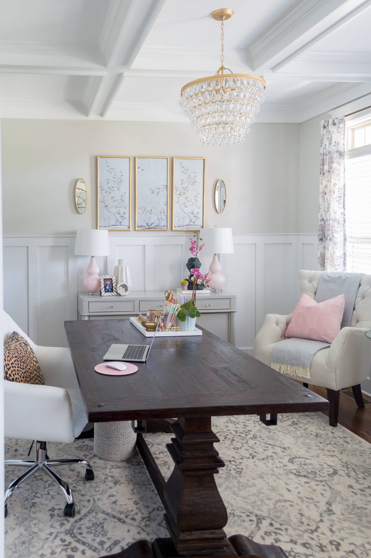 Chic and girly home office with farmhouse trestle table, DIY Gold chandelier, tufted arm chair.