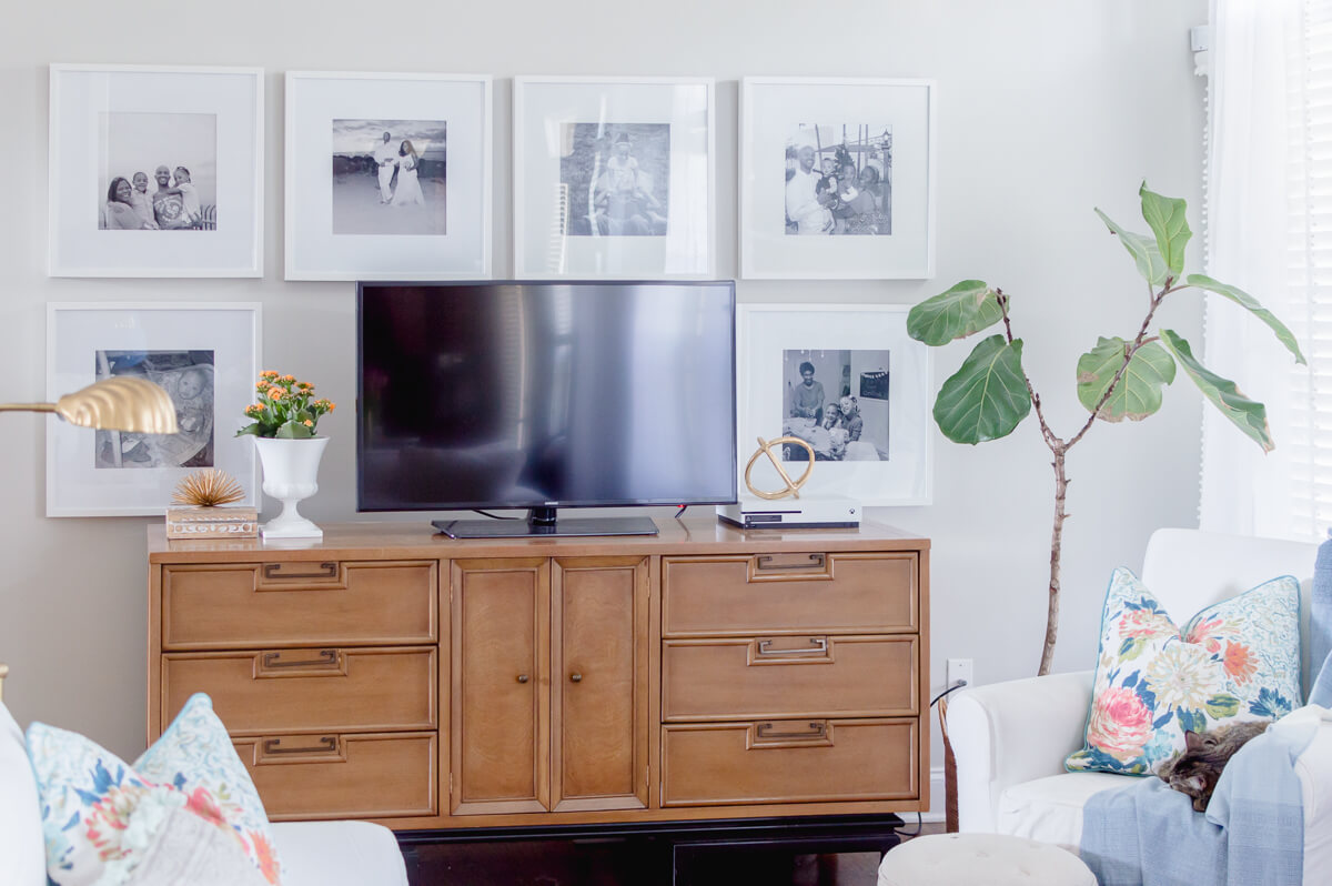 Tips for decorating around a TV and TV stand with Sherwin Williams repose gray paint. | the home i create