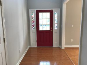 Entryway with red door