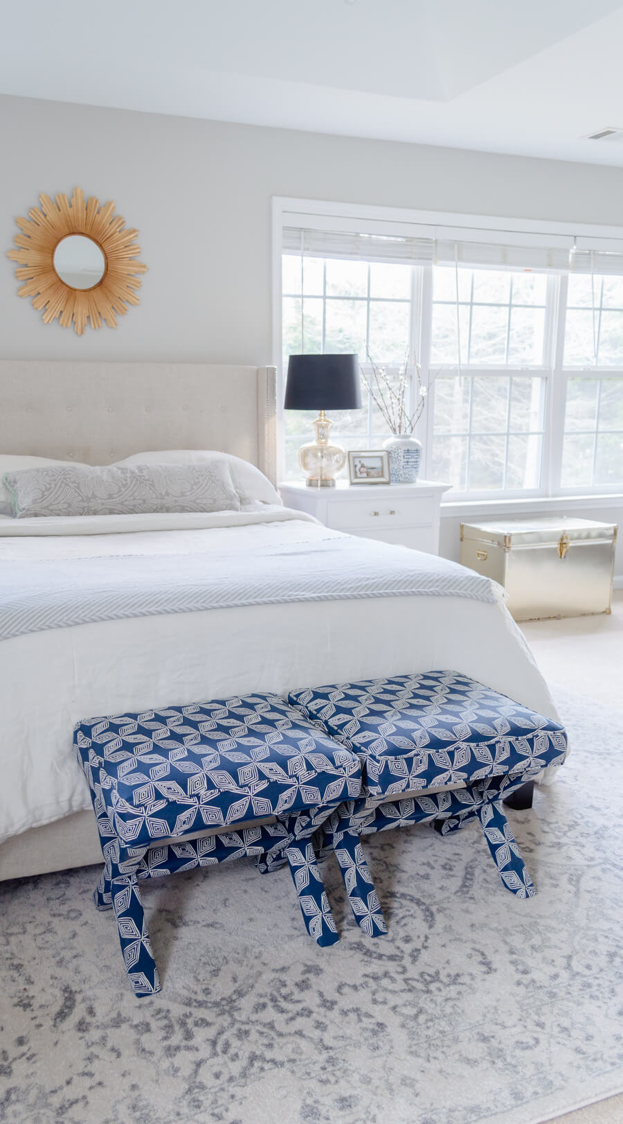neutral master bedroom update with blue accents