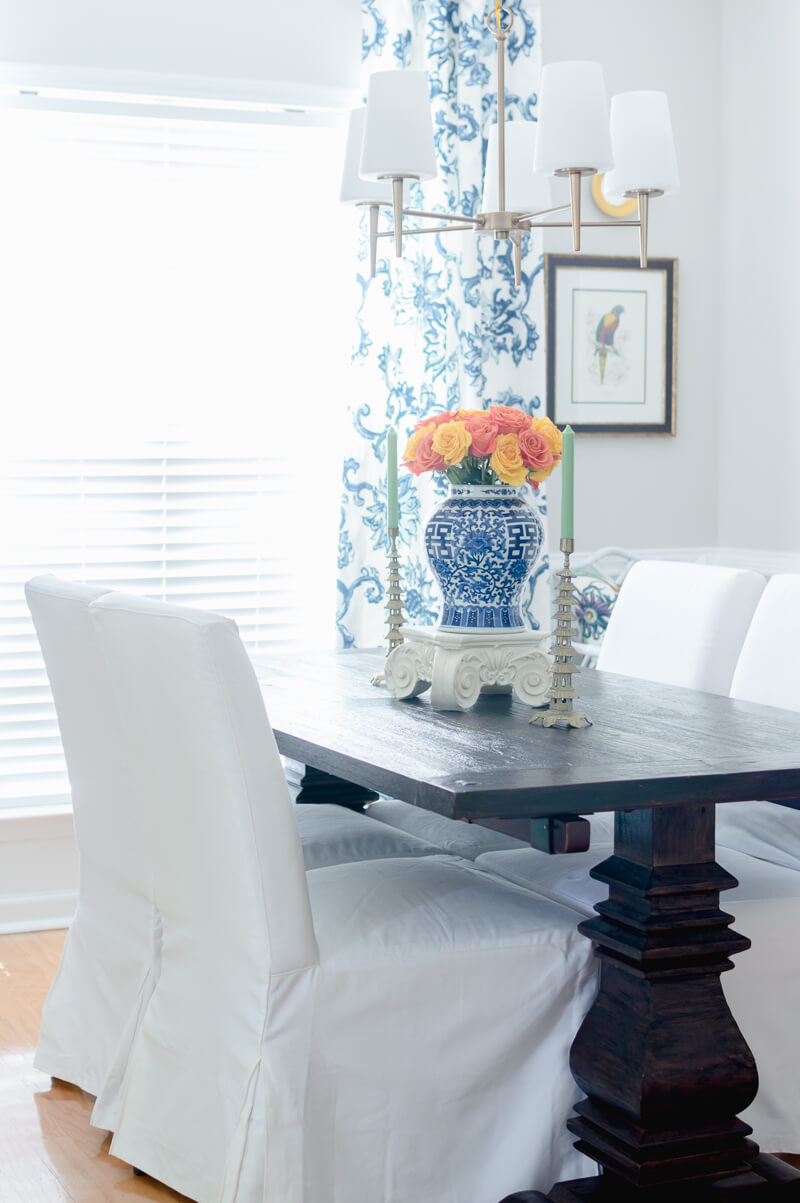 Farmhouse table with white slipcovered chairs