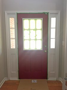 red front door ready for painting