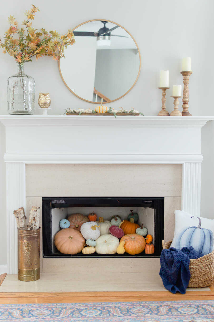 Blue and Orange Fall Home Tour Fireplace Filled With Pumpkin