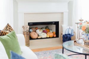 Blue and Orange Fall Home Tour Pumpkin Fireplace Decor