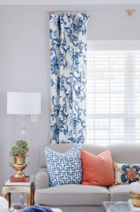 Blue and white curtains with lucite rod.