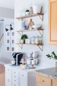 Open Shelves In The Kitchen With White Accessories