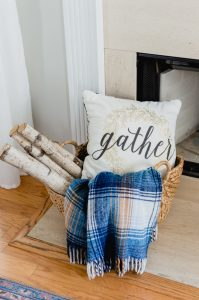 simple fall fireplace decor basket