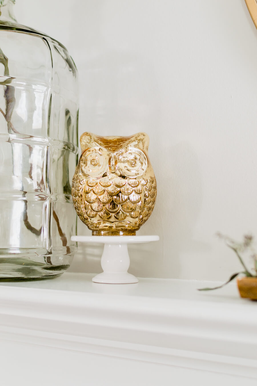 simple fall fireplace with gold owl