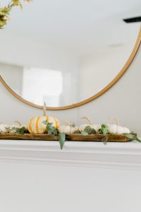 simple fall fireplace with white pumpkin