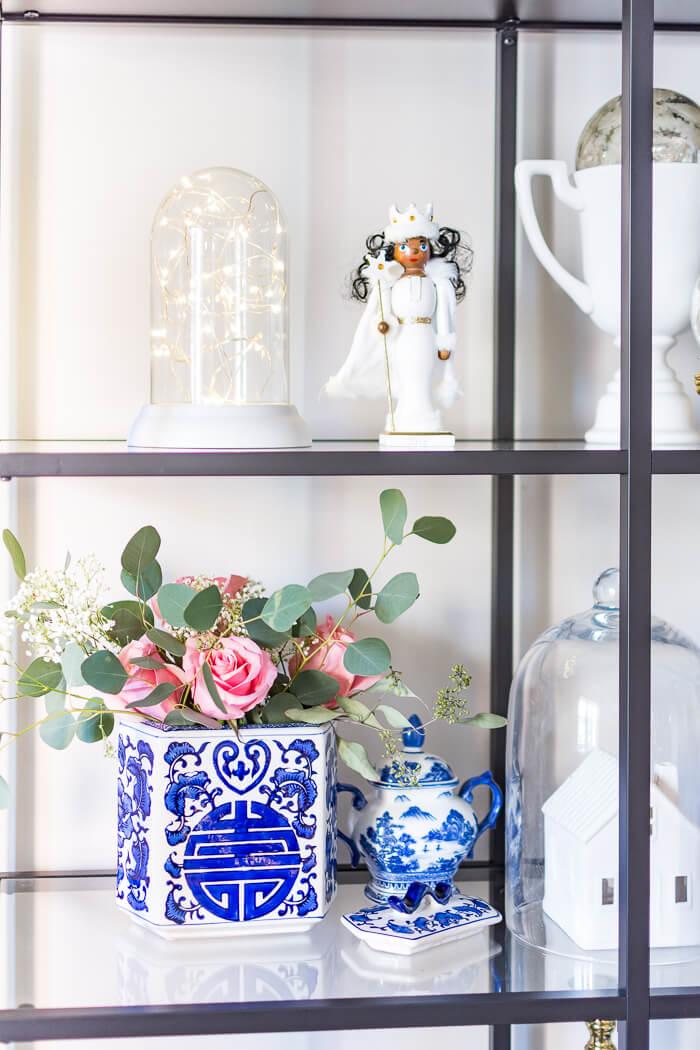 Blue and white Christmas decorations on Ikea Vittsjo shelf. #thehomeicreate #blueandwhite #livingroomdecor #christmasdecor