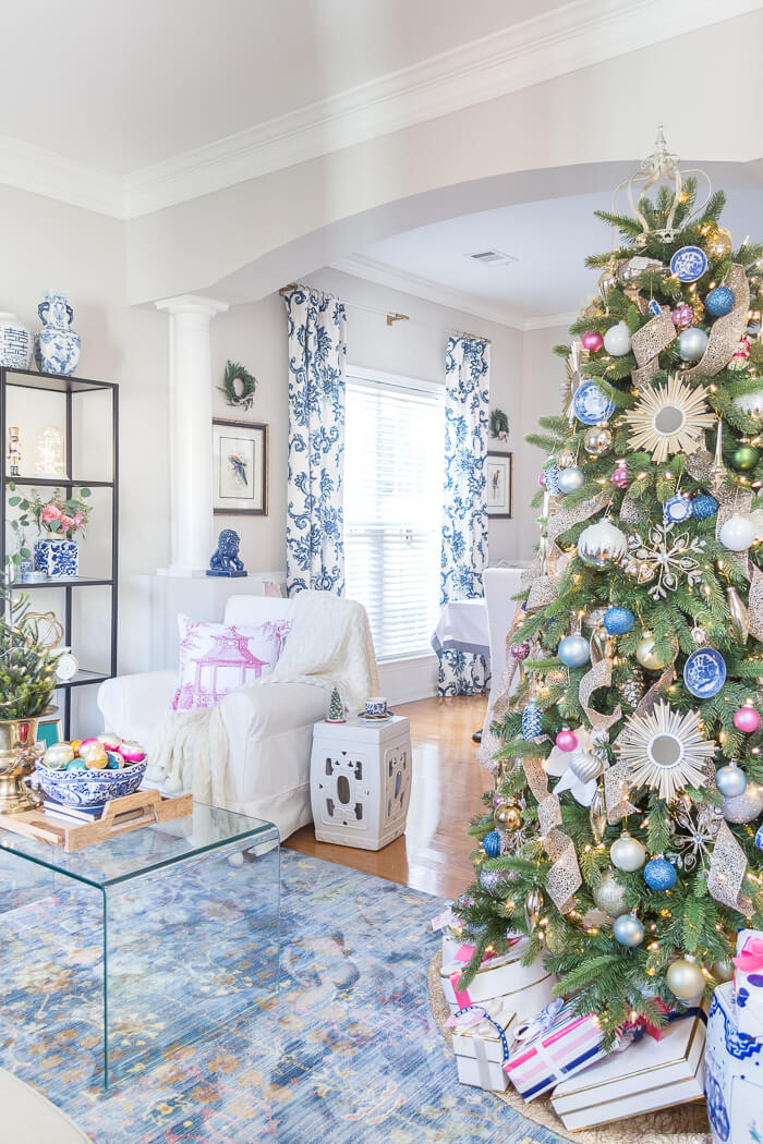 Blue and white Christmas living room with pops of pink. #thehomeicreate #blueandwhite #livingroomdecor #christmasdecor