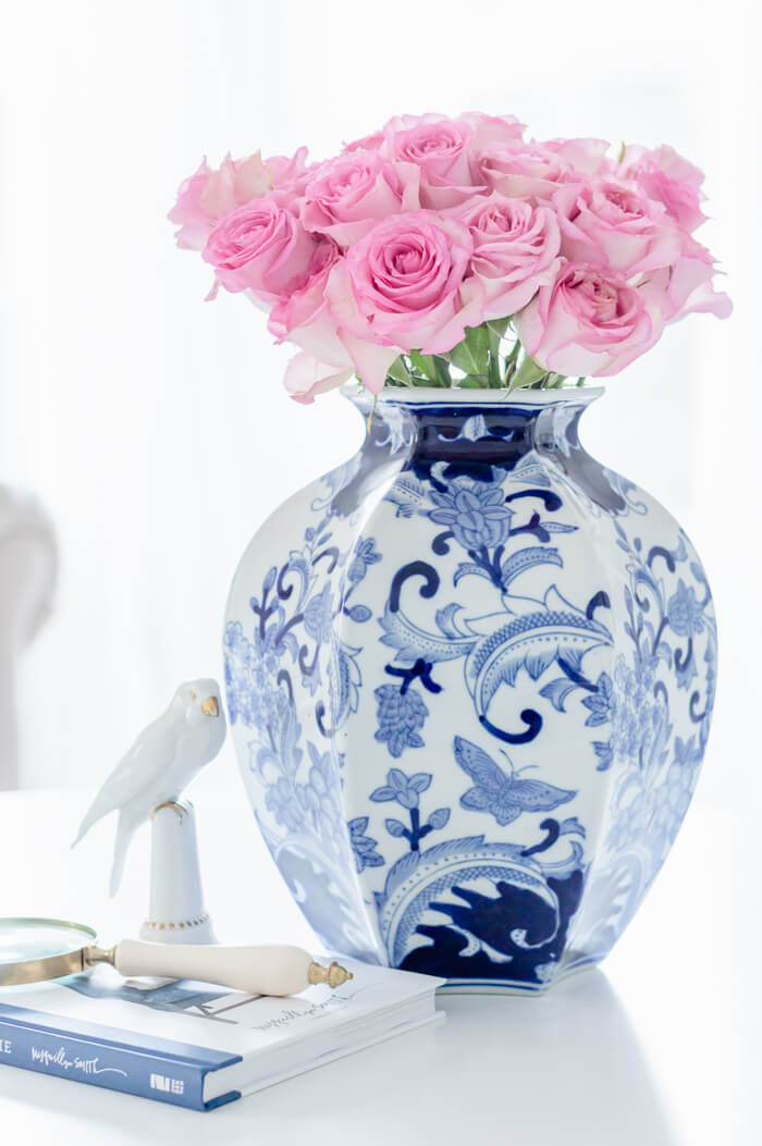 Blue and White Vase With Pink Roses