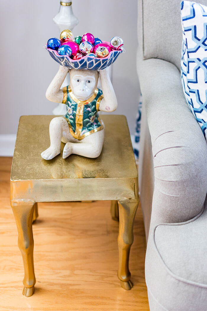 Colorful Christmas living room with vintage shiny brite ornaments in a vintage Chinoiserie Monkey. #thehomeicreate #blueandwhite #livingroomdecor #christmasdecor
