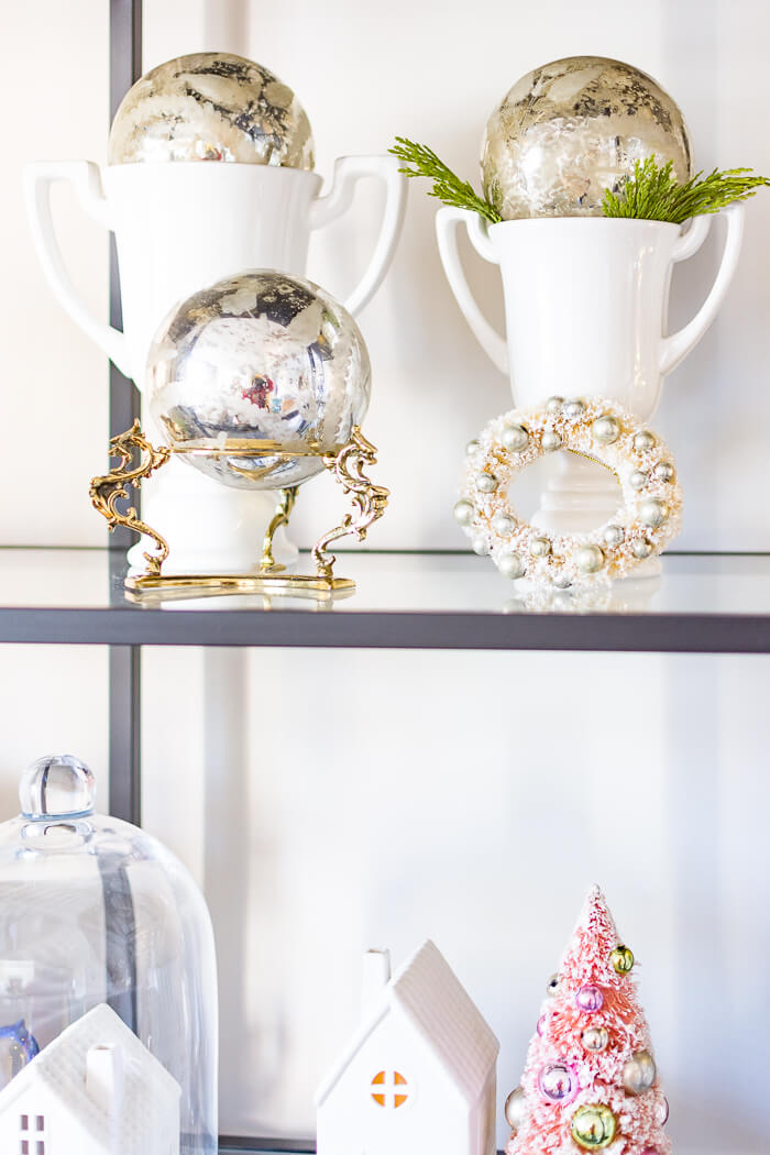 White Christmas decorations on Ikea Vittsjo shelf. #thehomeicreate #blueandwhite #livingroomdecor #christmasdecor