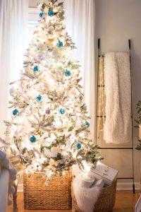 Flocked Christmas Tree With Blue Decor