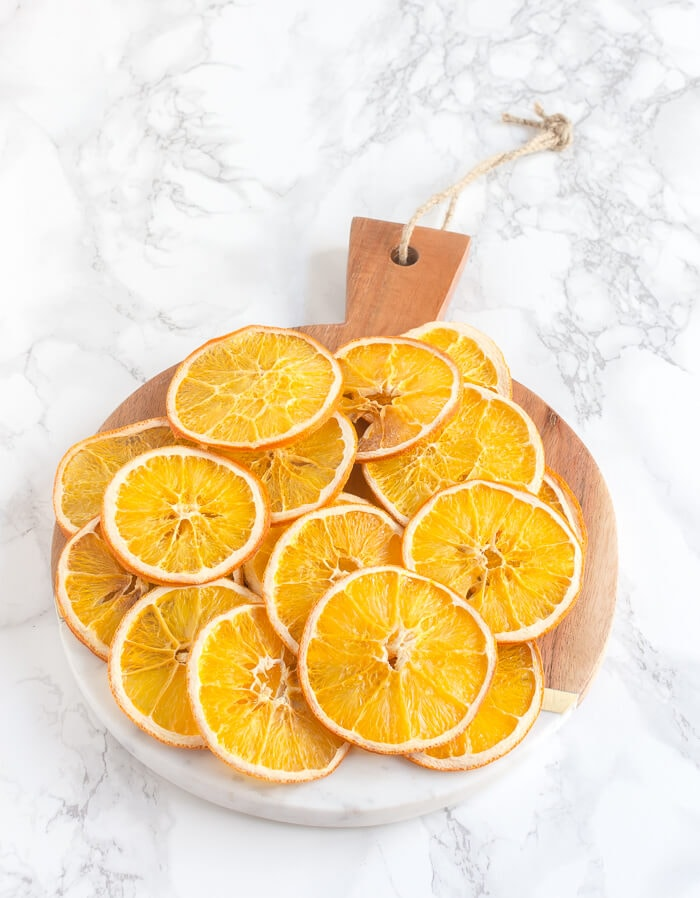 Step by step instructions on how to easily dry orange slices in the oven for Christmas crafts, potpourri, dessert garnish and more. #thehomeicreate #driedorangeslices #christmascrafts #holidaydecor #holidayncrafts #christmasdecor #orange