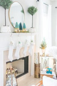 White and gold Christmas fireplace decor