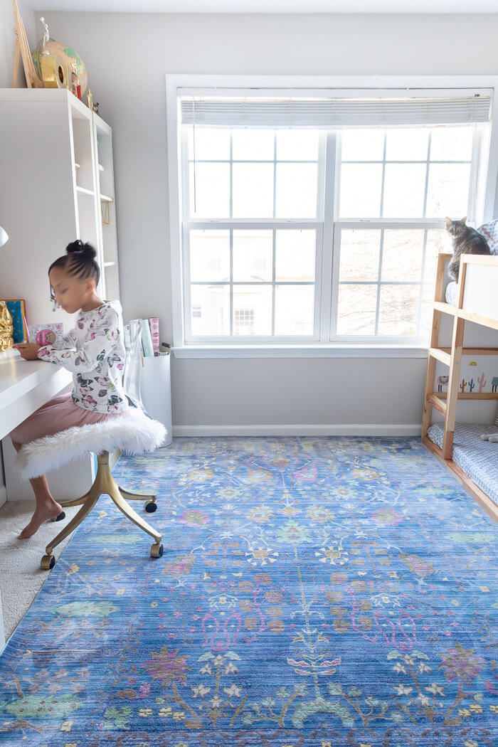 Blue rug in little girls room