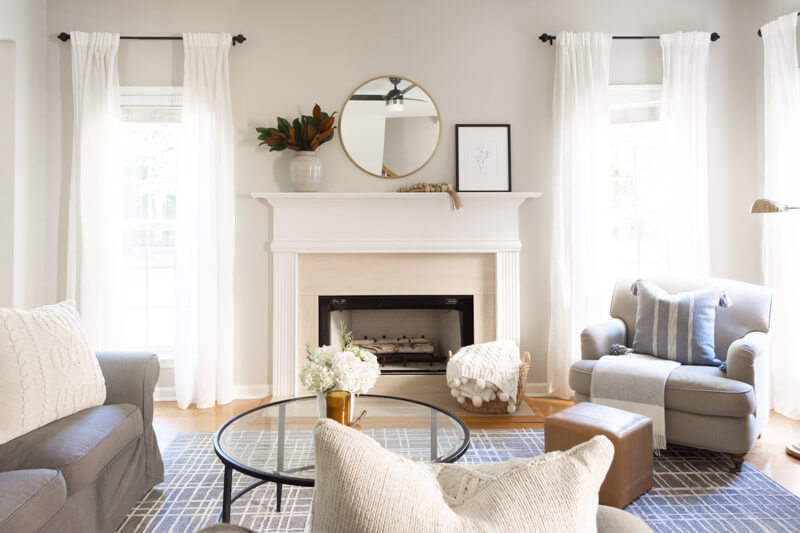 neutral armchair by the fireplace family room deco