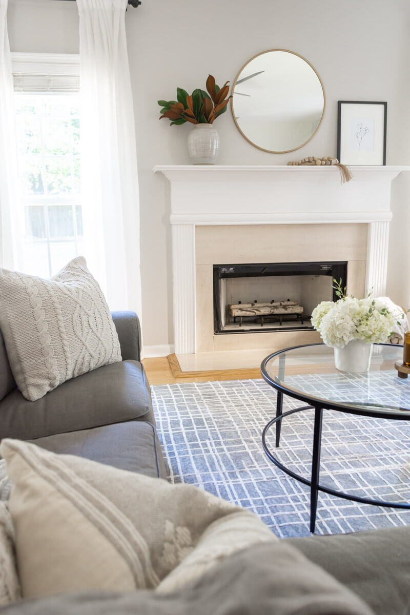 simple and neutral family room with gray rug