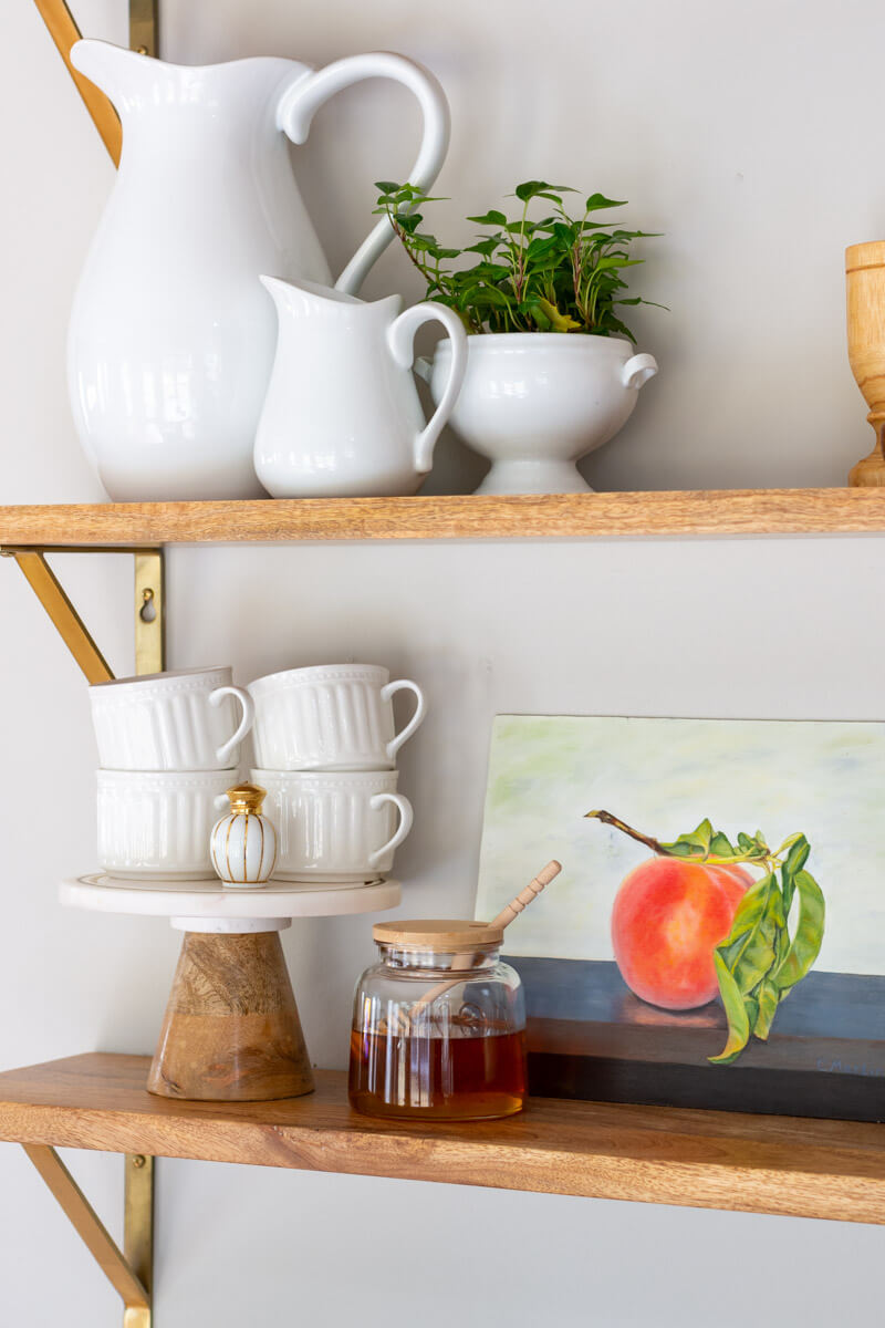 Open-shelves-with-vintage-peach-painting